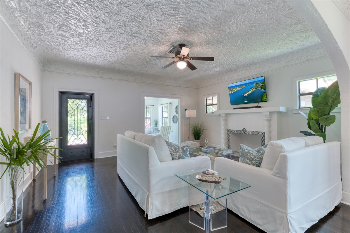 The Living Room is a site with it's classic Palm Beach Island decor, decorative fireplace and large Smart App TV with Cable. There is a pull out Sleeper Sofa for 2! The room sits off the Den and Dining Room, perfect for quality time spent together.