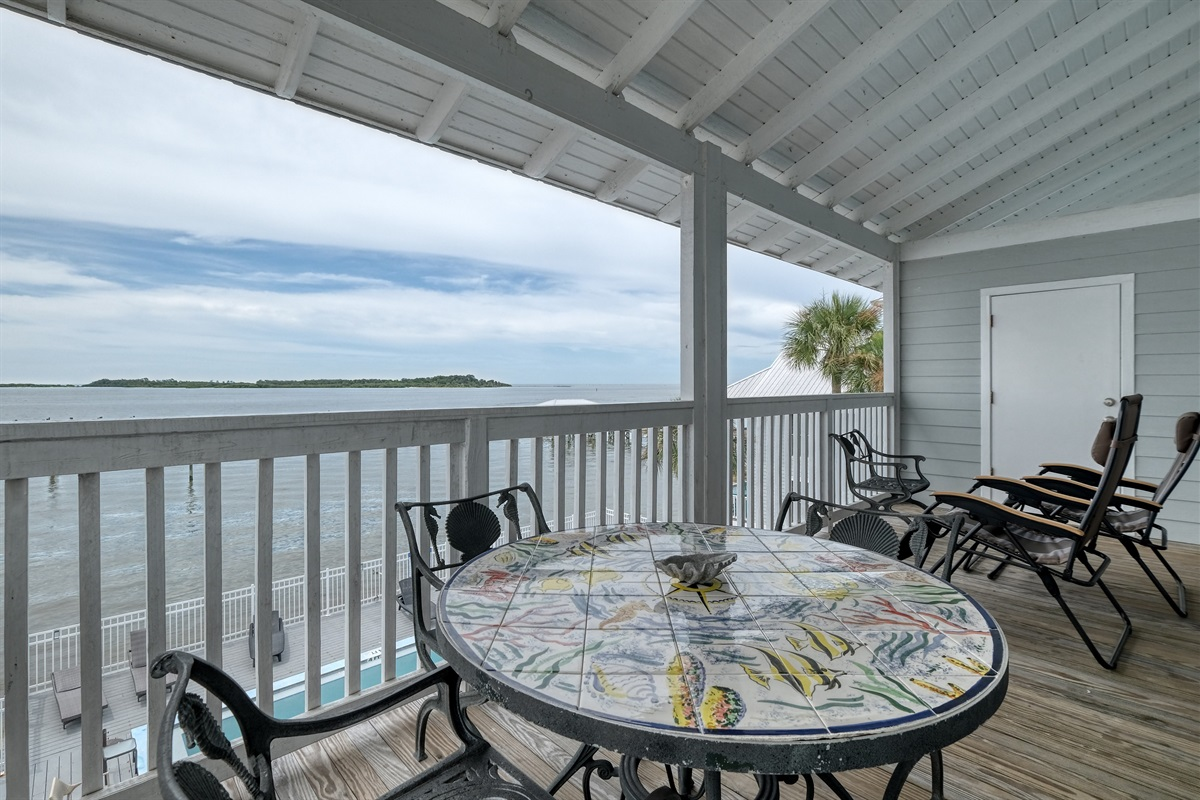Seating to relax and dine on the porch