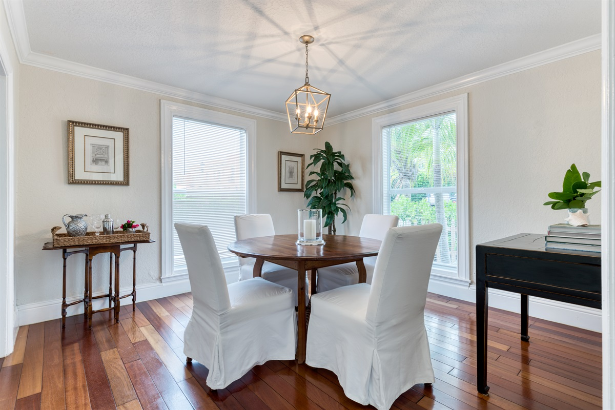 The perfect dining room to enjoy a meal with the crew. Natural light fills the room, rich hardwood flooring and small side bar area.
