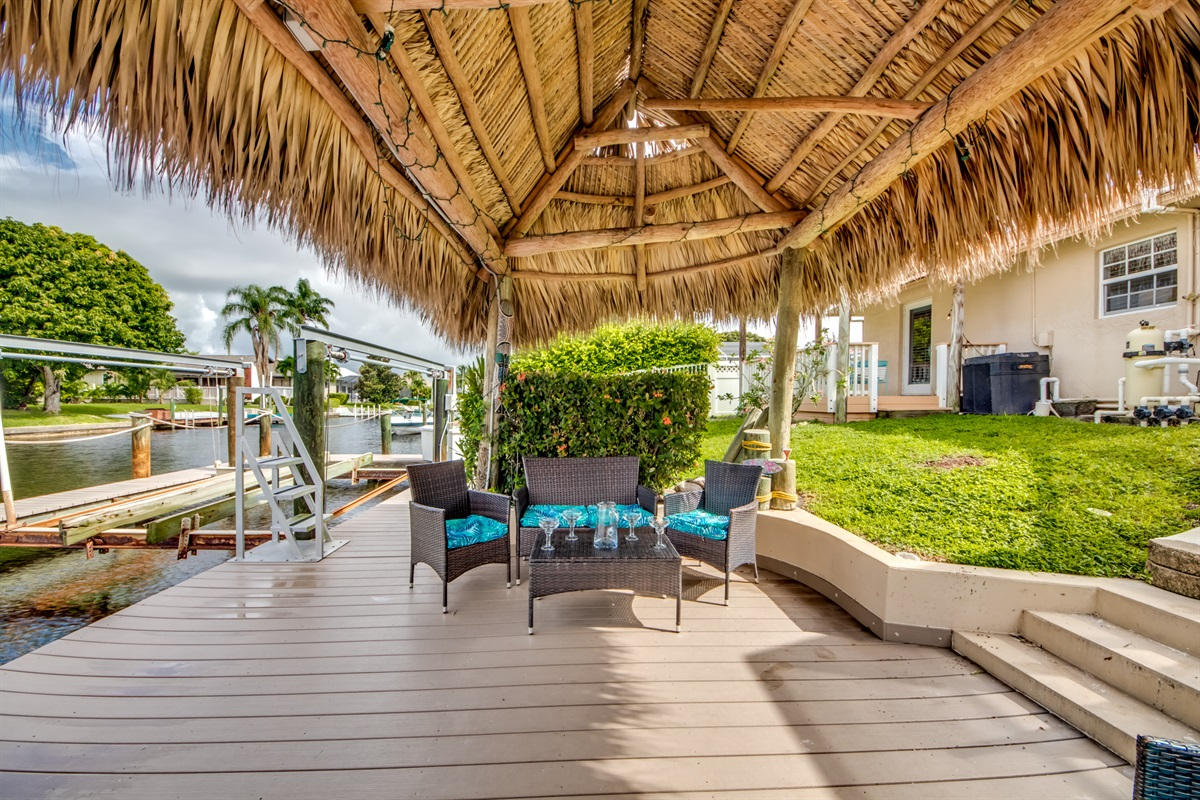 Comfortable seating in tiki hut with lights