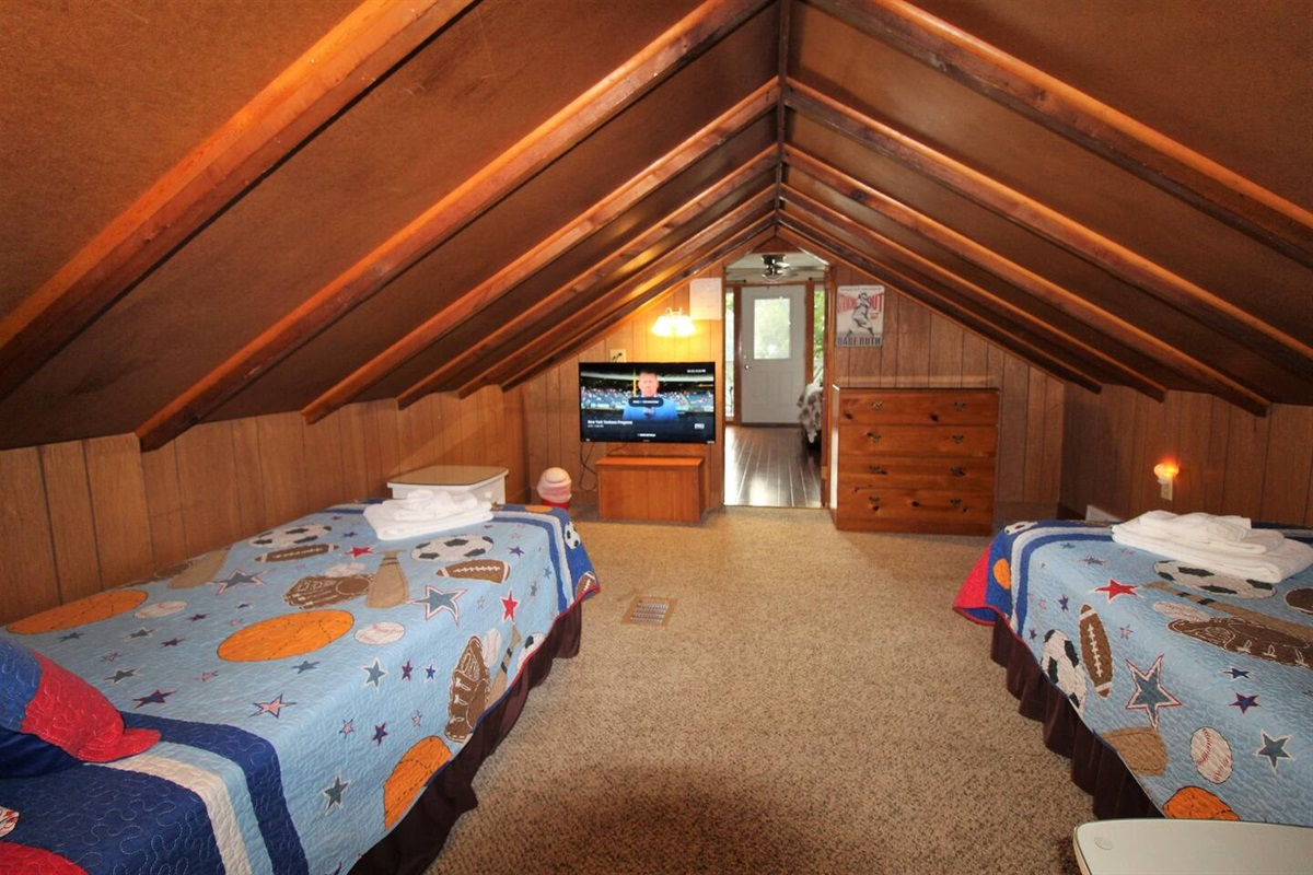 """Twin bedroom - """"railroad style"""" leads into the  upper level queen bedroom suite"""