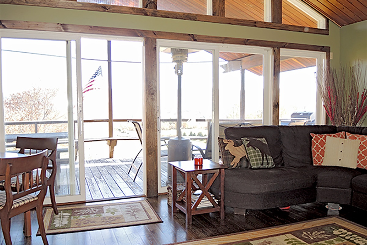 Living Room with sliding doors leading to covered front porch