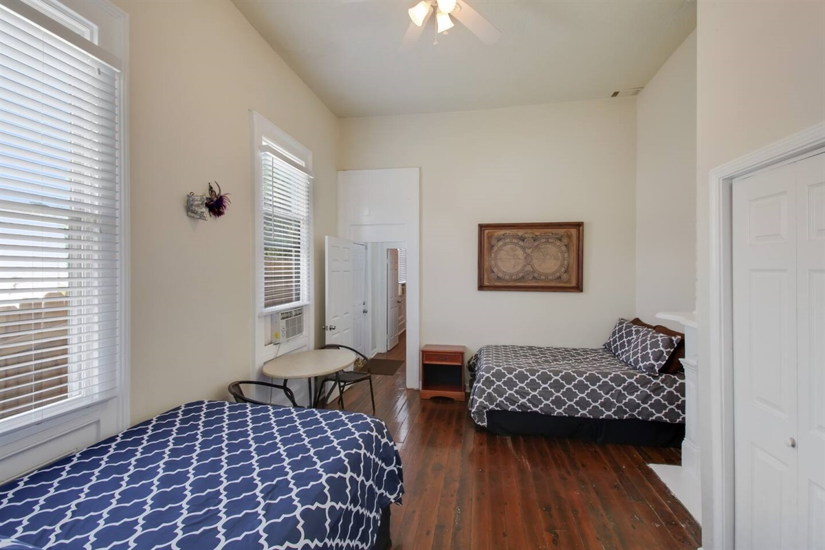Bedroom 1 - downstairs - 2 full beds, dedicated AC unit - looking in from French Doors. BRAND NEW MEMORY FOAM MATTRESSES.