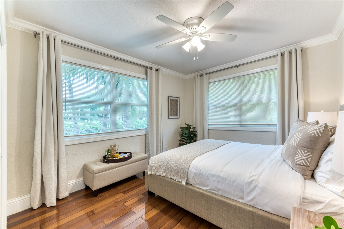 Chic 3rd Bedroom with Queen bed and big windows bringing in gorgeous natural light.