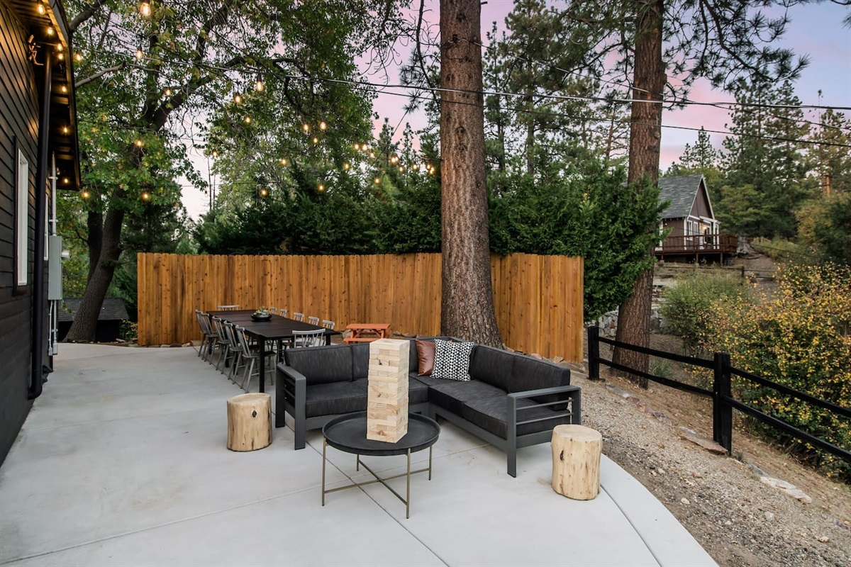 Sitting area and large outdoor dining table on back deck.