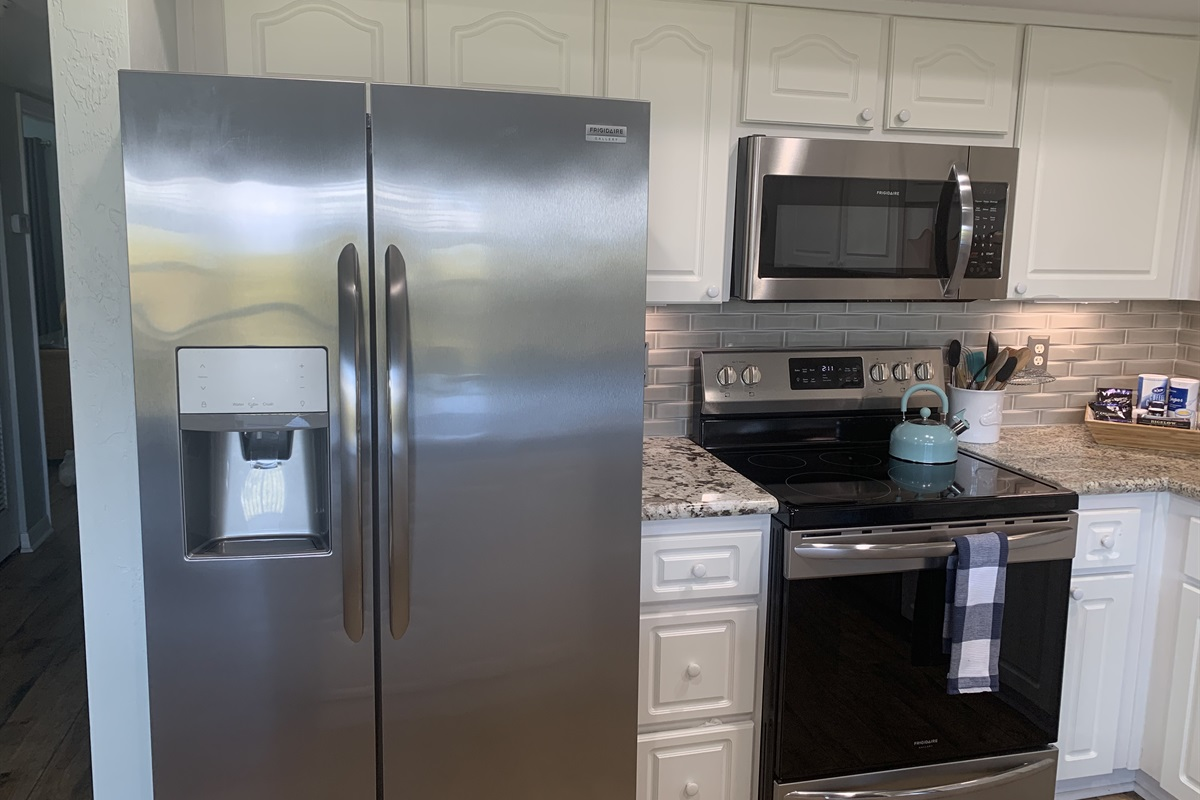 Stainless Fridge/Range/Oven and Microwave