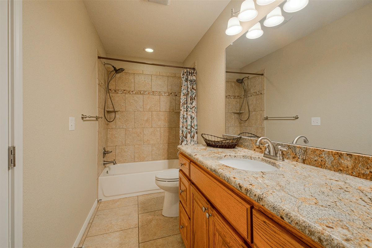 Cottage Bath (tub & shower) + Stacked washer/dryer