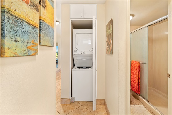 Stacked washer and dryer in closet.