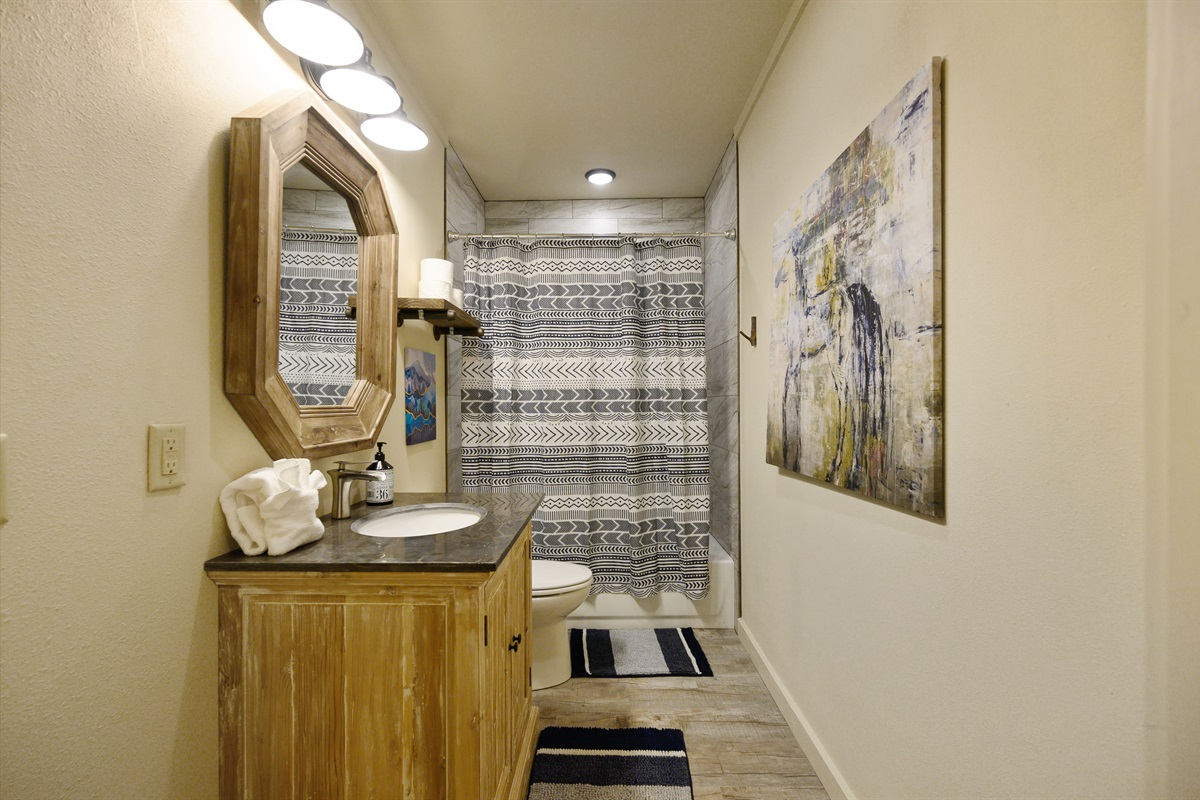 Bunk bath includes a full tub and shower combo