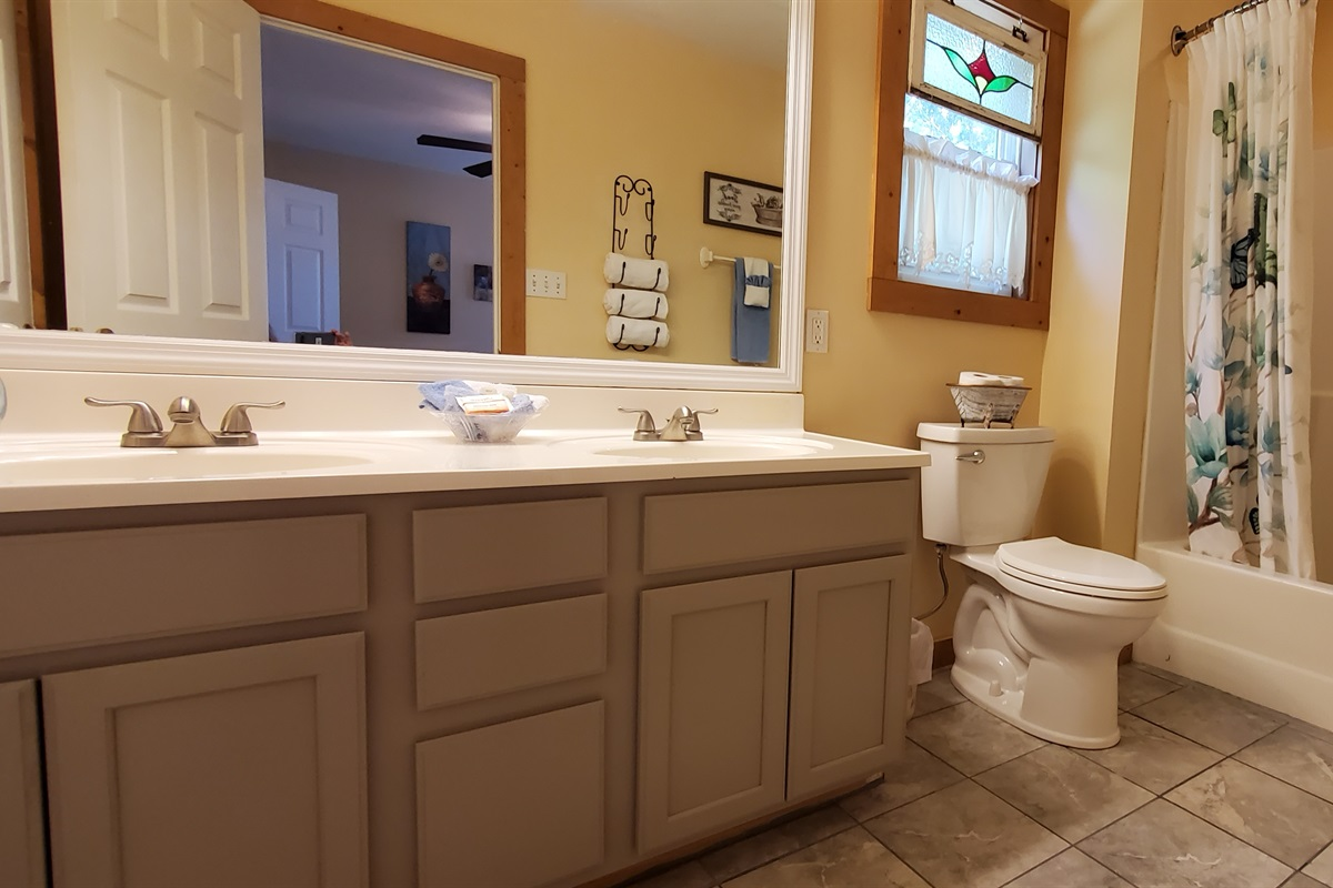 Newly remodeled full bathroom off the queen bedroom upstairs.