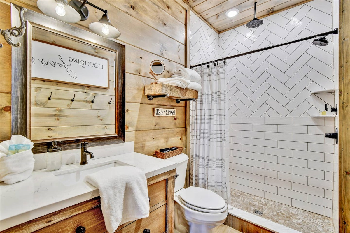 Wolf Den En-Suite bath with walk-in shower featuring BOTH a rainfall and traditional shower head. Plenty of room for two.