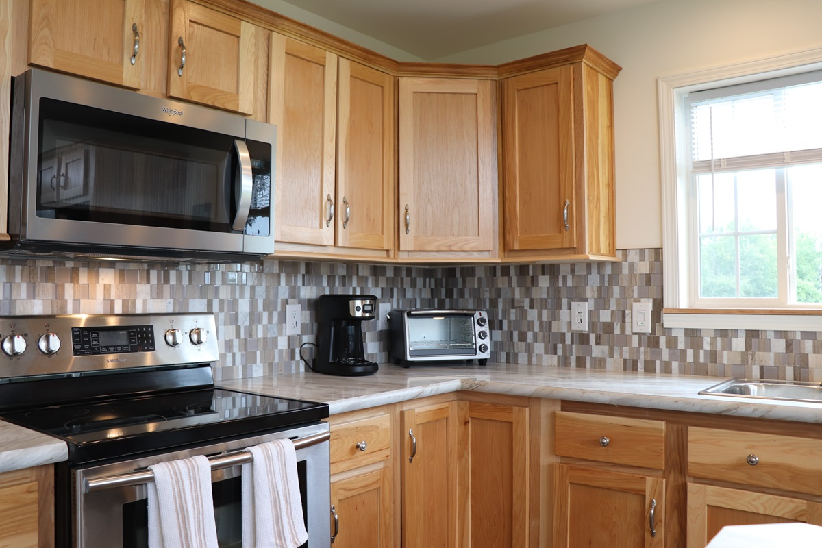 New kitchen with stainless steel applicances