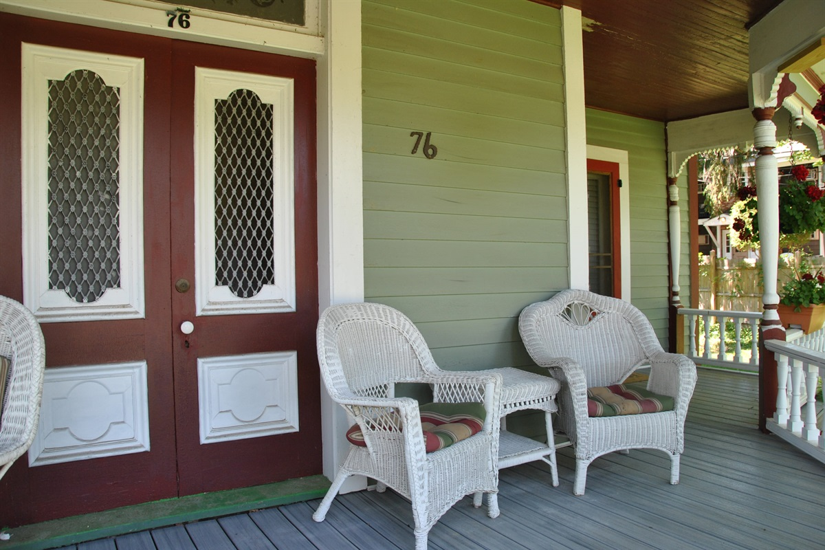 Sitting area on porch for guests.