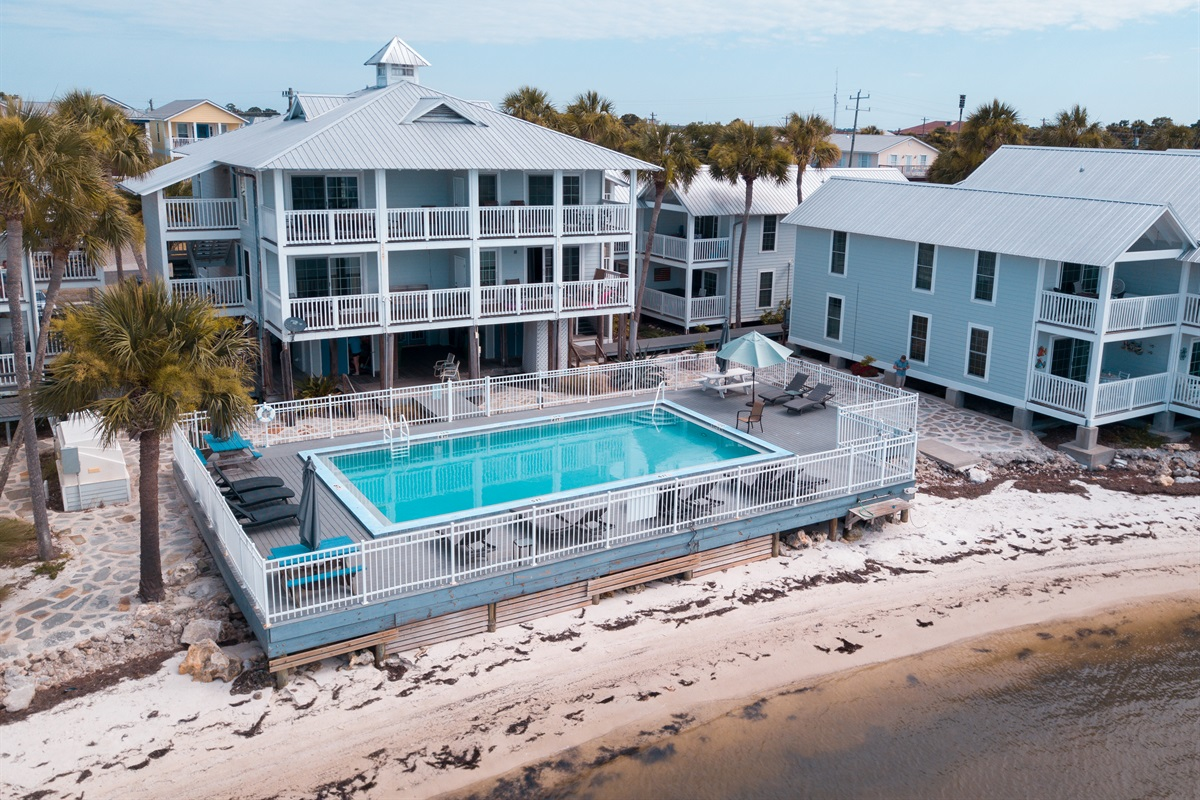 Enjoy the pool or lounge down on the sand by the Gulf