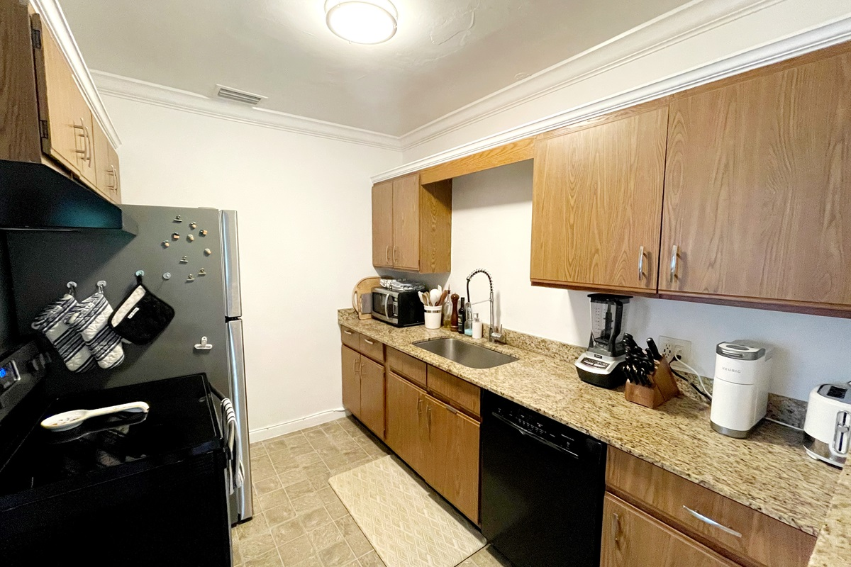 Fully equipped kitchen with Stainless steel fridge, Keurig, blender, toaster & all utensils you need to  whip up a delicious meal for the hungry crew.