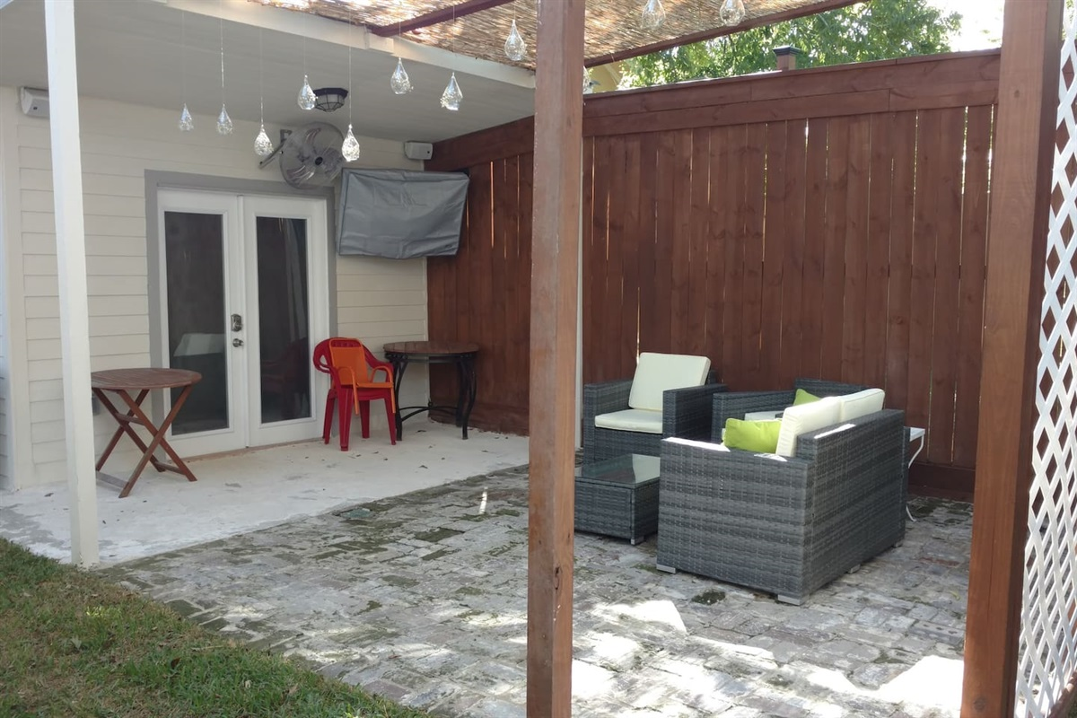 Back yard with charcoal grill.