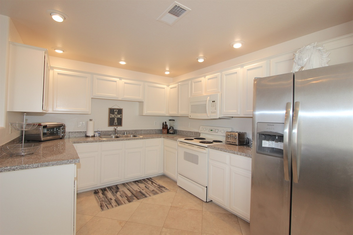 Kitchen with granite counter tops, new stainless steel refigerator. refridge