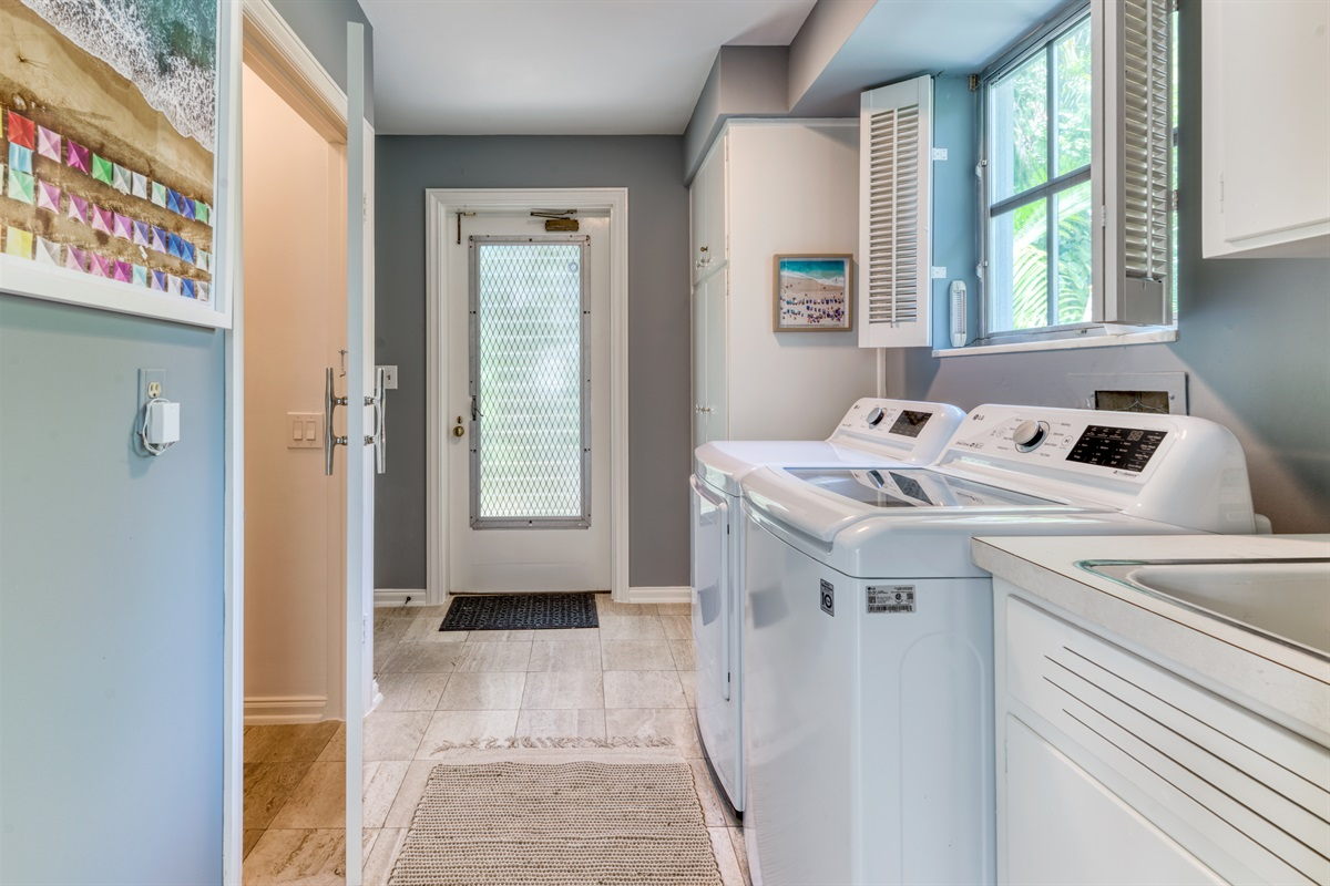 Large Capacity washer and dryer in the the laundry room with all detergents you need. There is access to the garage from this room with the 4 beach cruiser bikes.