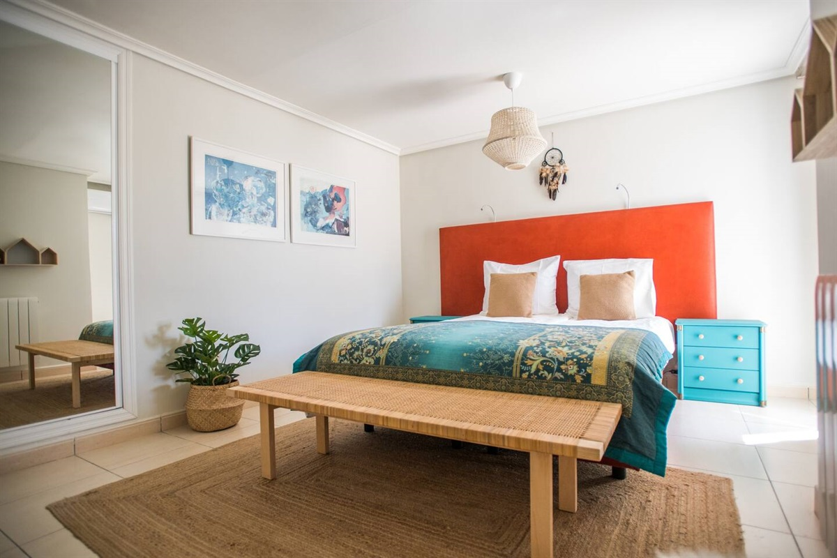 Spacious master bedroom of the guesthouse. All bedrooms have air conditioning.