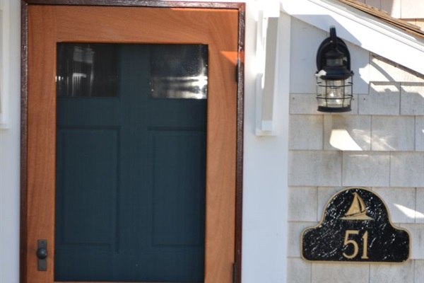 Custom mahogany storm doors reflect the rich maritime heritage of this property.