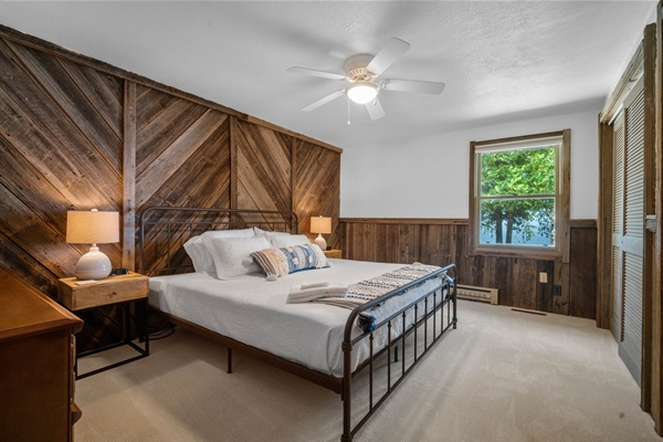 The spacious master bedroom features a king bed and water views.