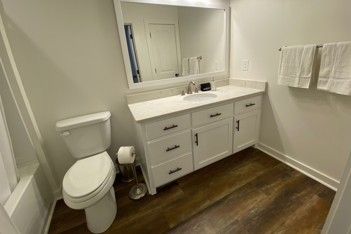 Fresh White Towels & Bathroom Essentials provided.