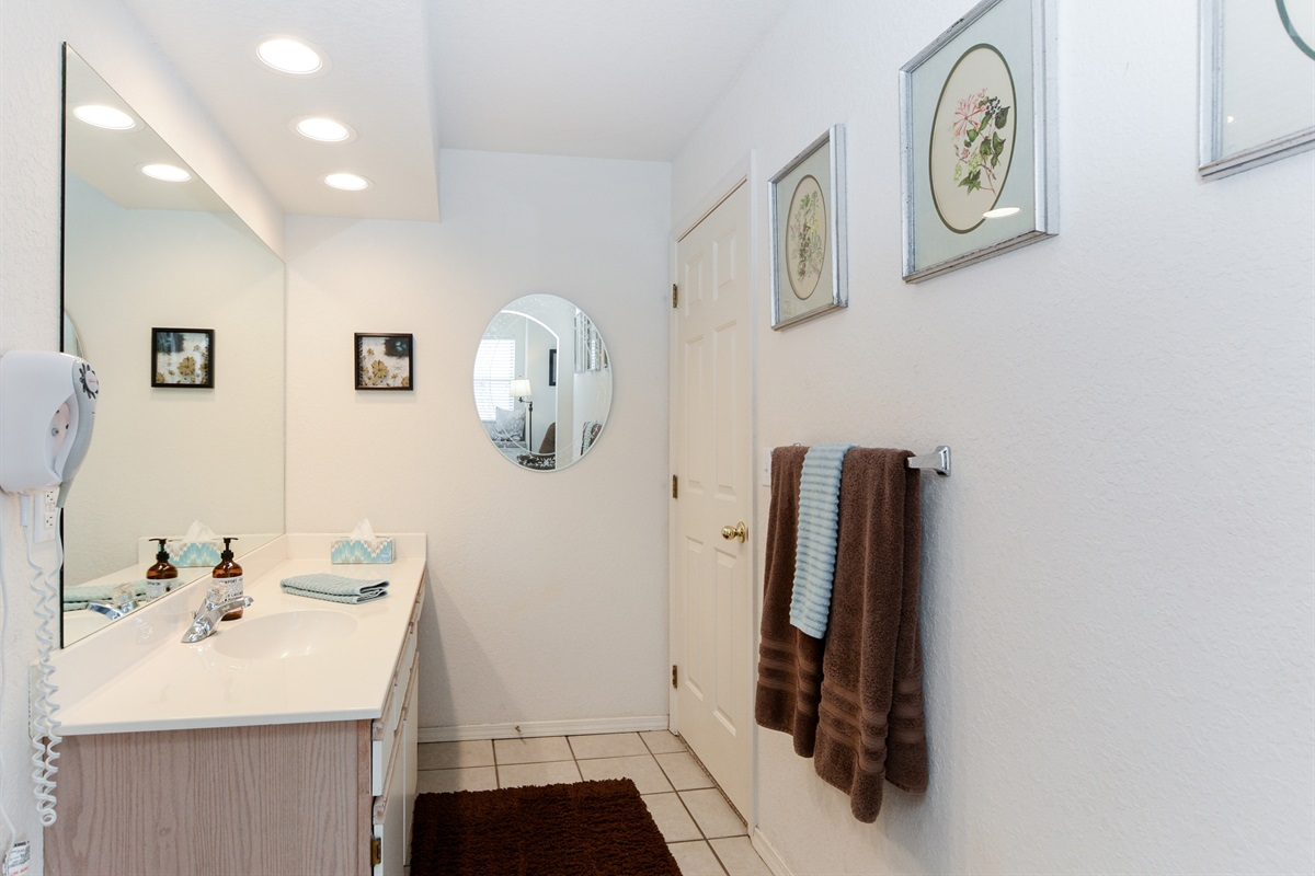 The master suite's large bathroom has plenty of room to get ready in the morning