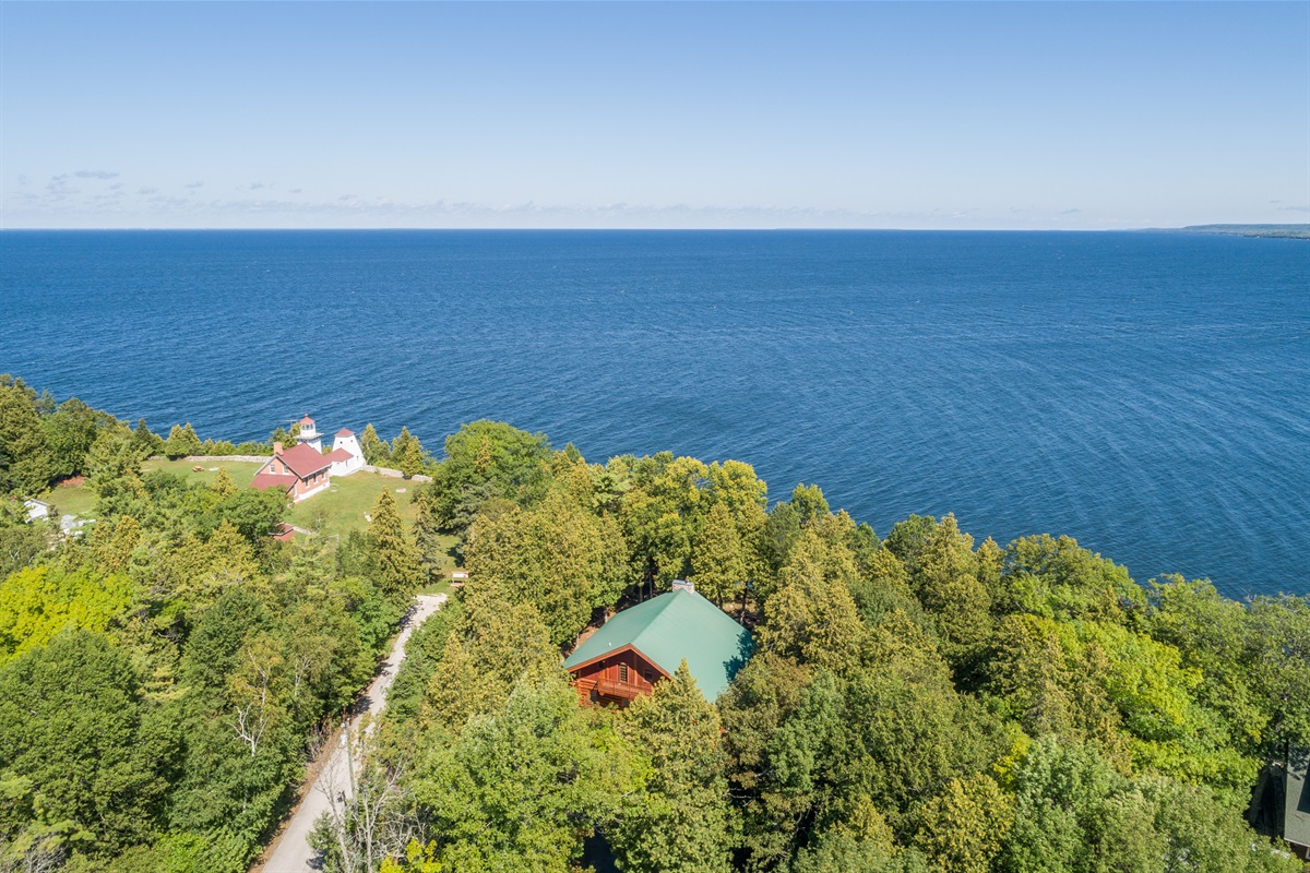 Aerial view of Sherwood Point Lodge! Right next to Sherwood Point Lighthouse on the end of a dead end road.