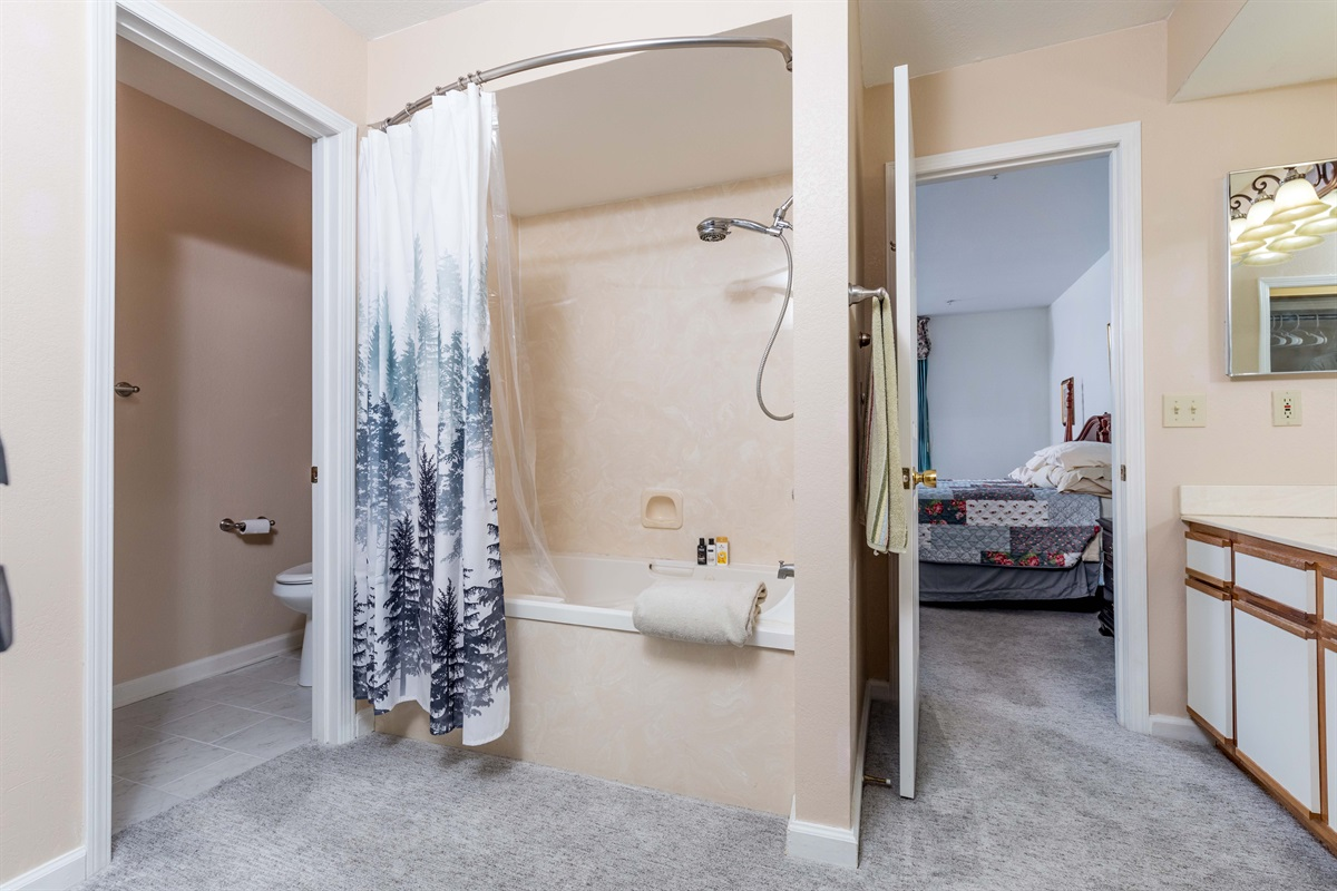 The oversized master bathroom offers plenty of space for getting ready