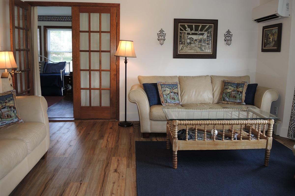 Living room /  door leading into 1st floor bdrm