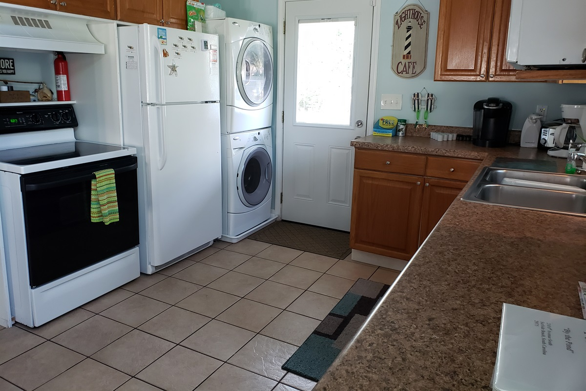 Fridge, stove, and full laundry