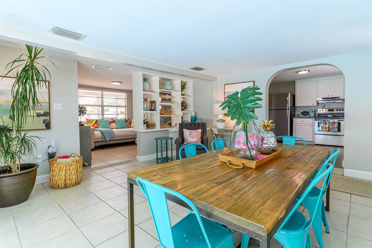 The dining area is open to the kitchen and the daybed room.