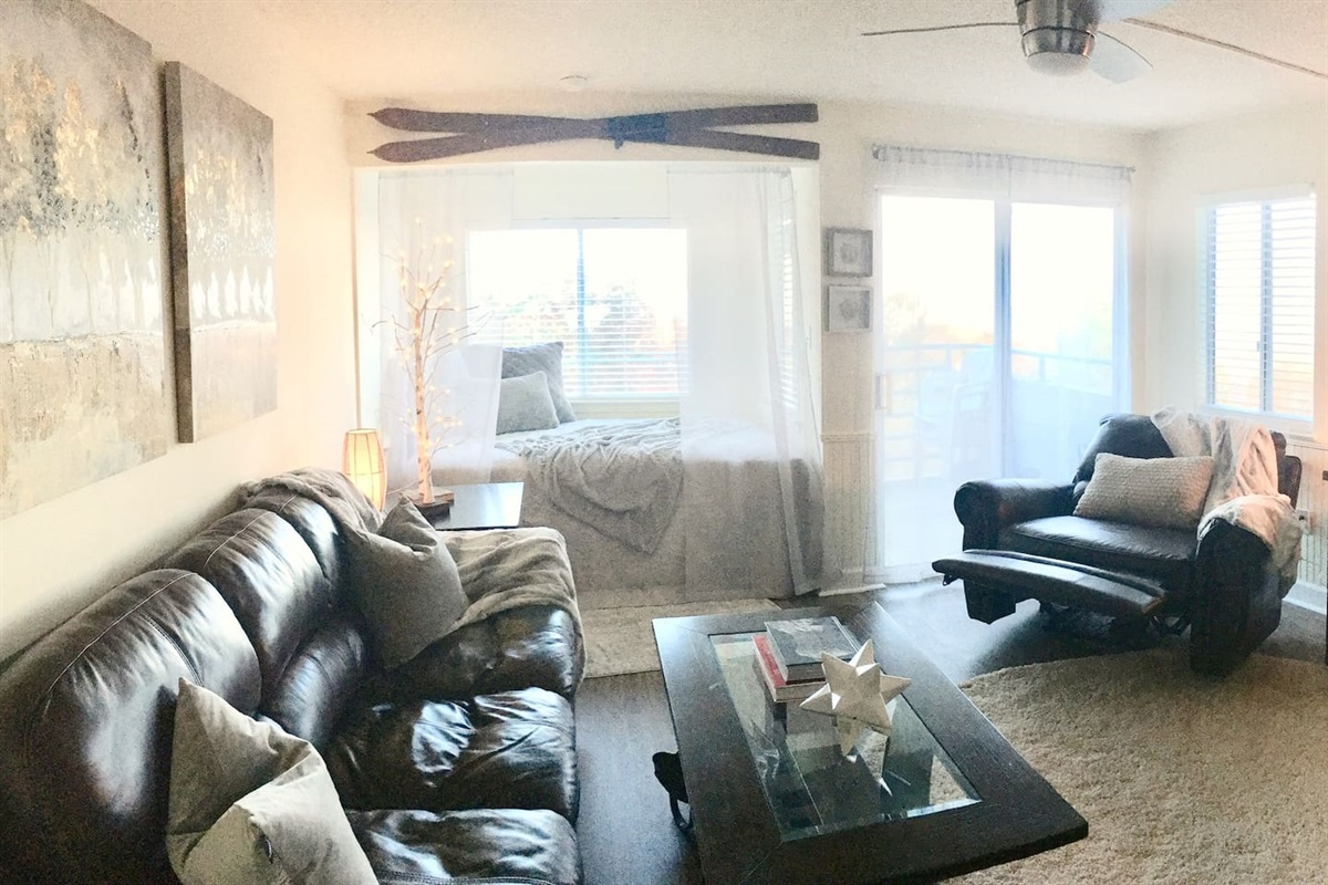 Cushy relaxation all around with leather couch + massage recliner + queen bed