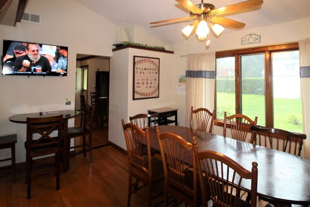 Main Dining Area with flat screen smart Roku TV to keep up on the scores while making dinner