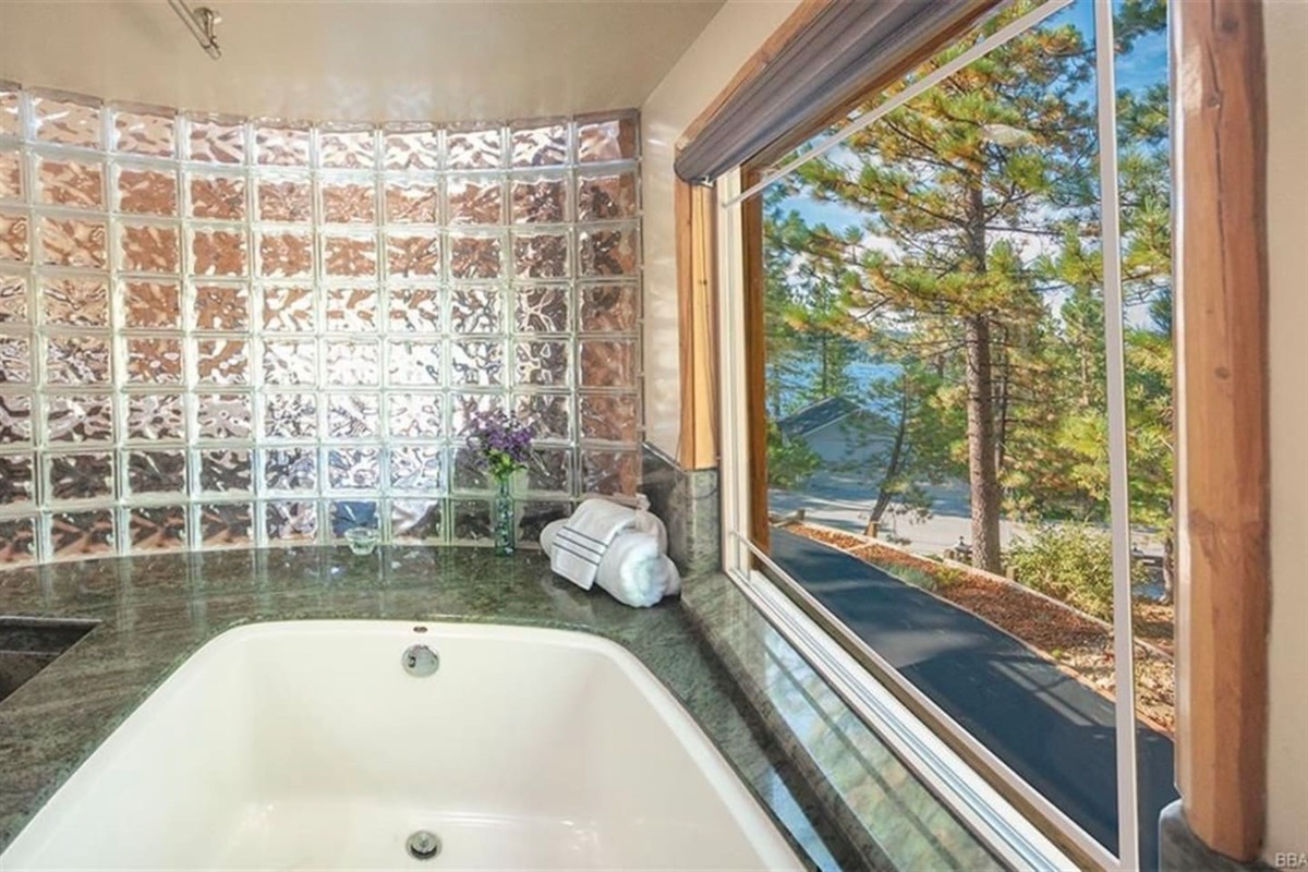 Bathroom #2: Ensuite bathroom to Bedroom #2 with lovely mountain and lake views from luxurious spa.