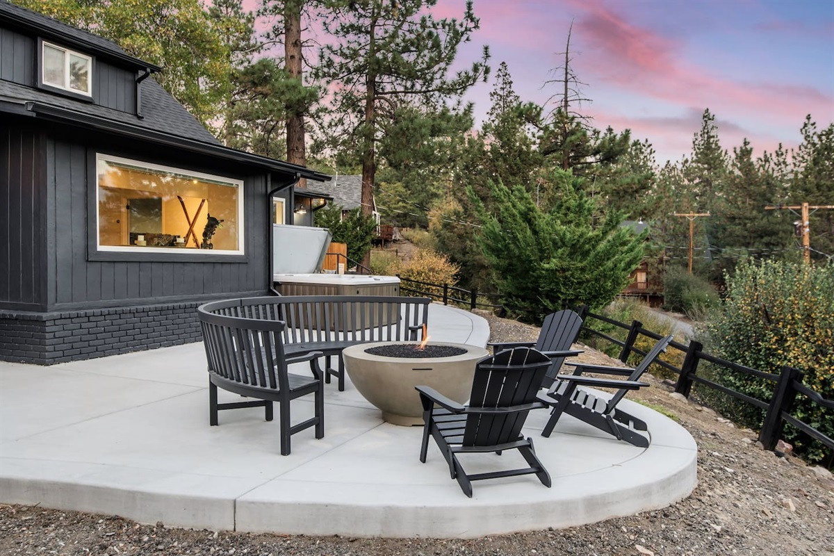 Back deck with gas fire-pit and cozy seating area by the hot tub.