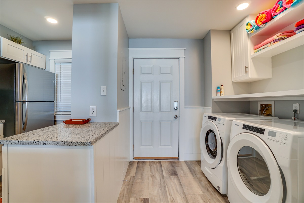 full size laundry station in unit.