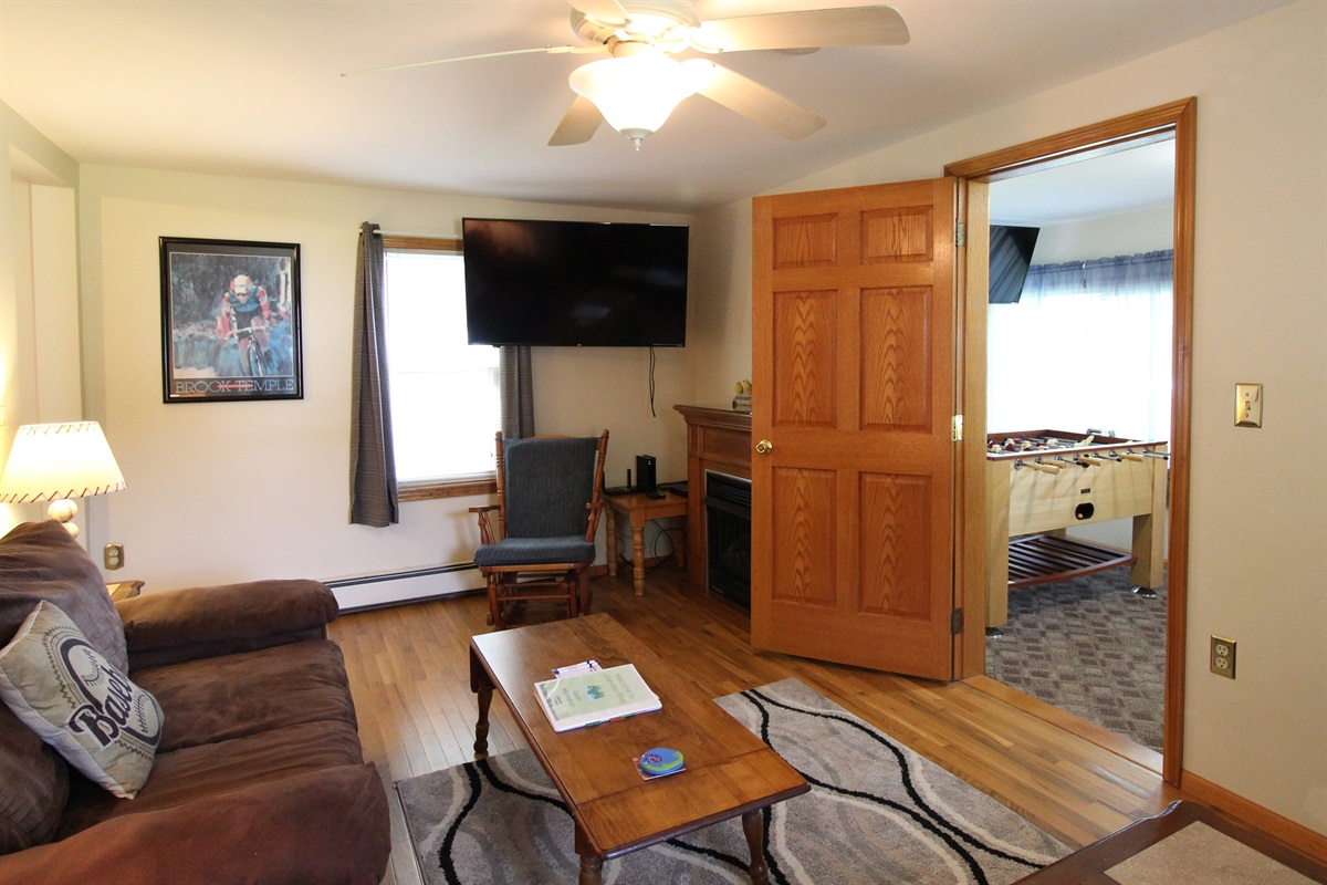 """Large living room with 55"""" (or larger) flat screen smart TV with Roku.  Bring your favorite streaming app and never miss one of your favorite shows!  (New hardwood floor replaced carpeting in"""