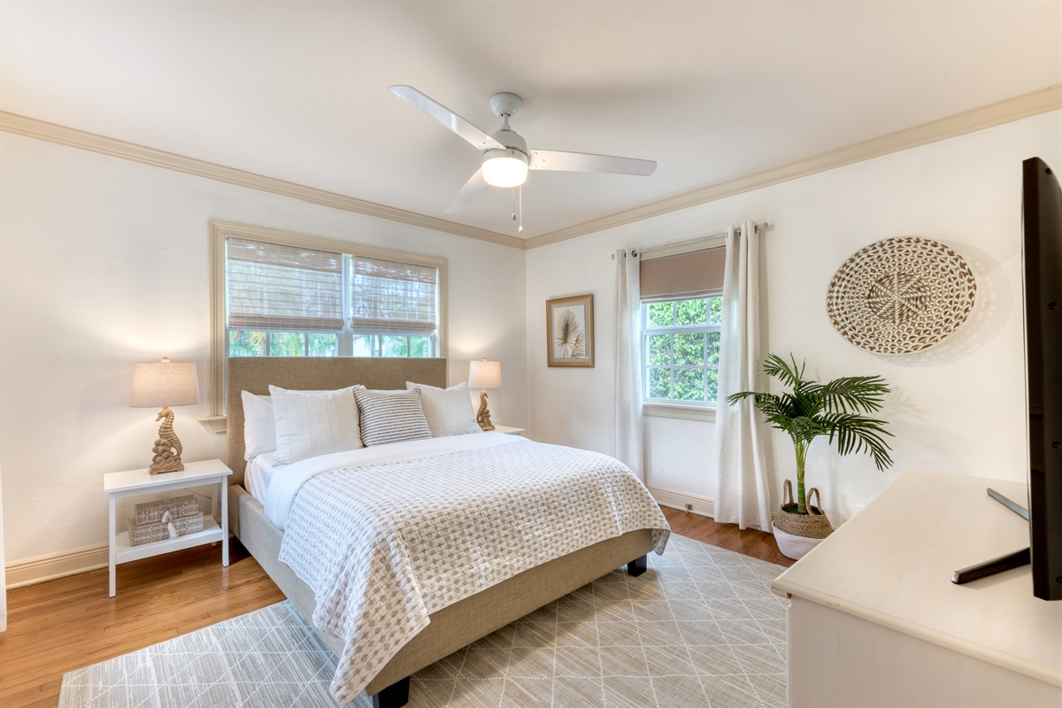 Bedroom 1 with Queen sized bed, tasteful whites, creams and beige colors brighten the room. Smart App & Cable TV with en-suite bathroom.