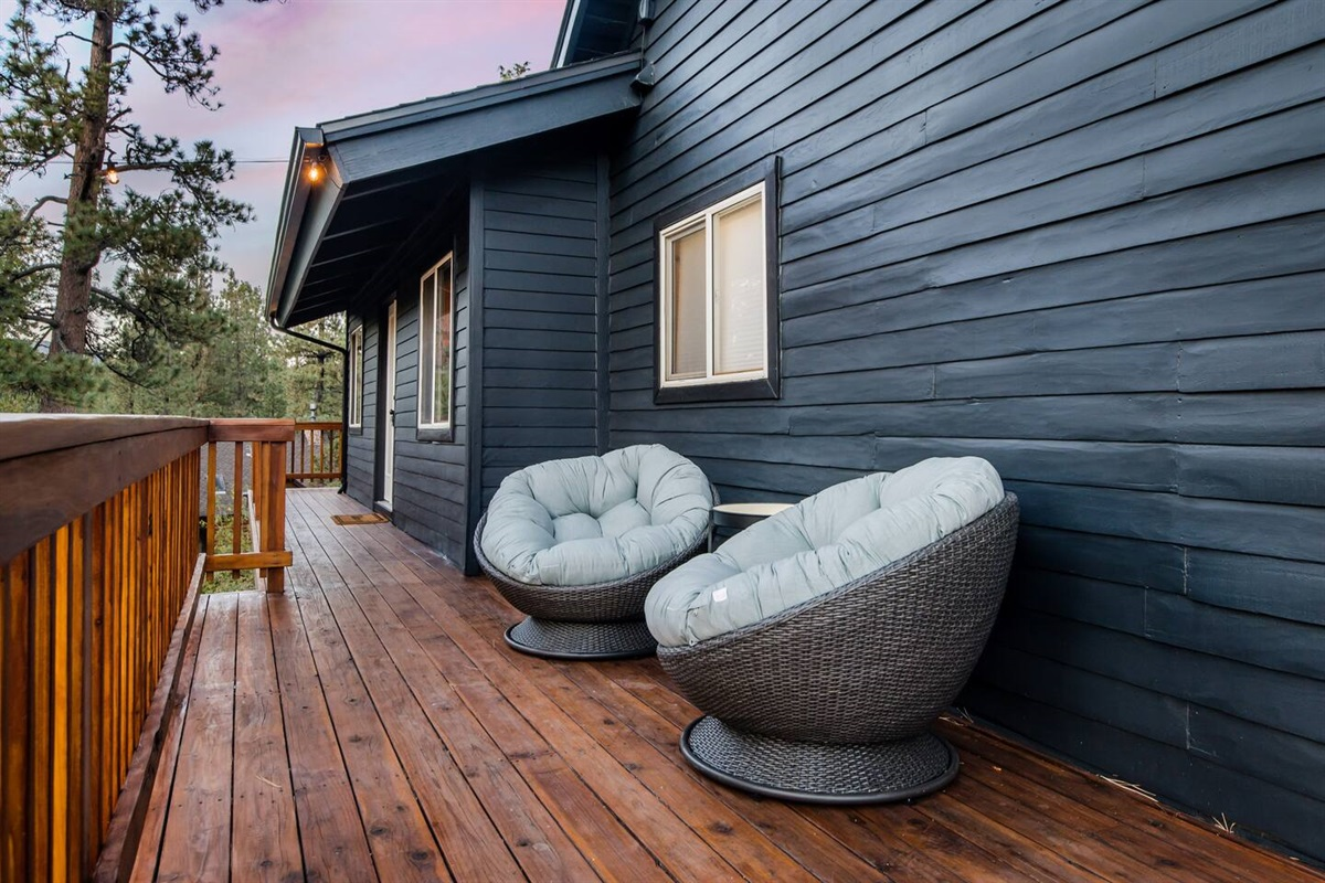 The back deck and wraparound porch offer several sitting areas for gathering with family and friends.
