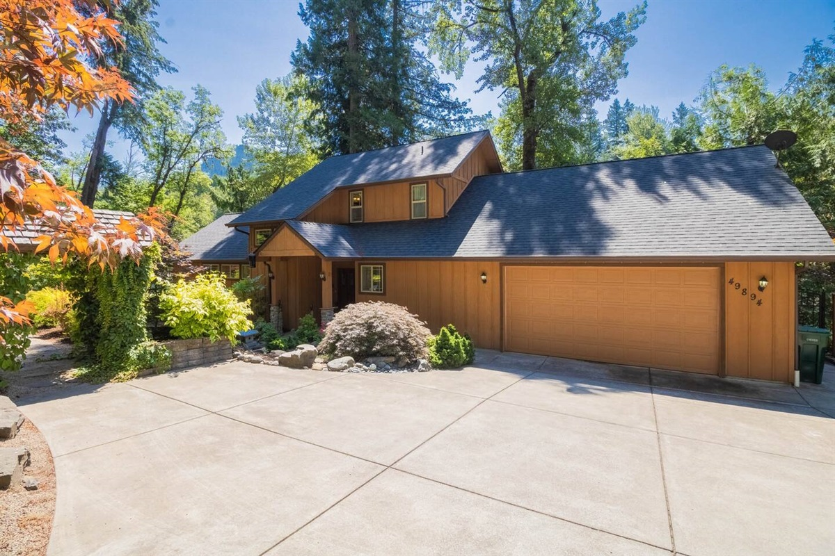 Front of the home with driveway with ample parking for large families and groups.
