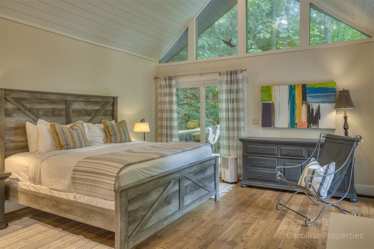 Spacious master bedroom with king size bed