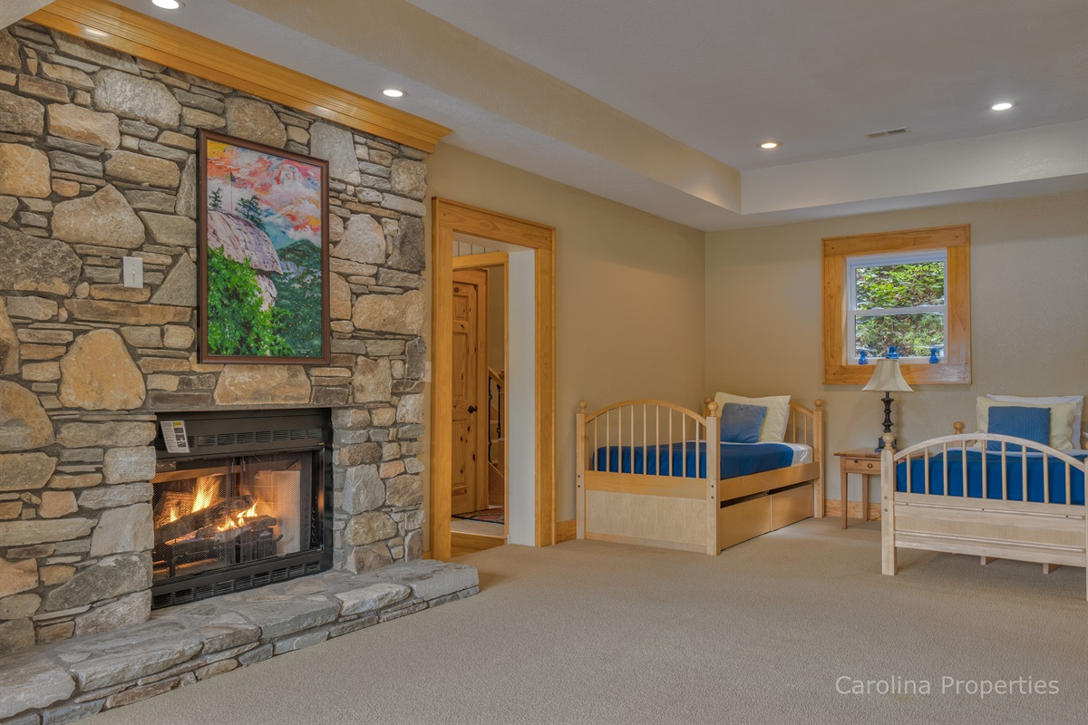 Two twin beds with fireplace