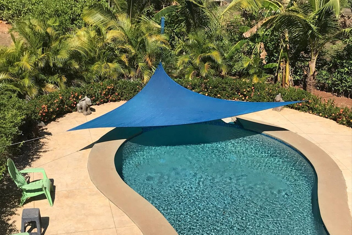 Our pool with a sun sail shade for a cool spot when it gets too warm!