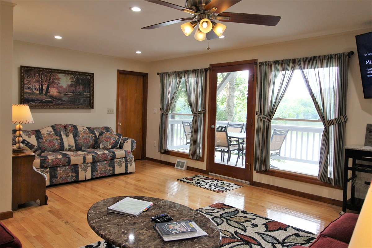Large windows overlooking the deck and Goodyear Lake