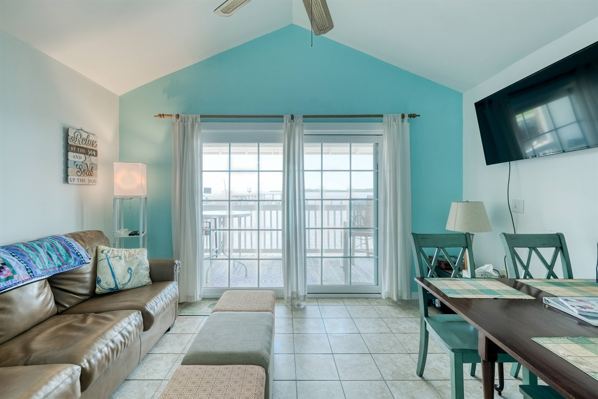 Large sliding glass doors lead to porch