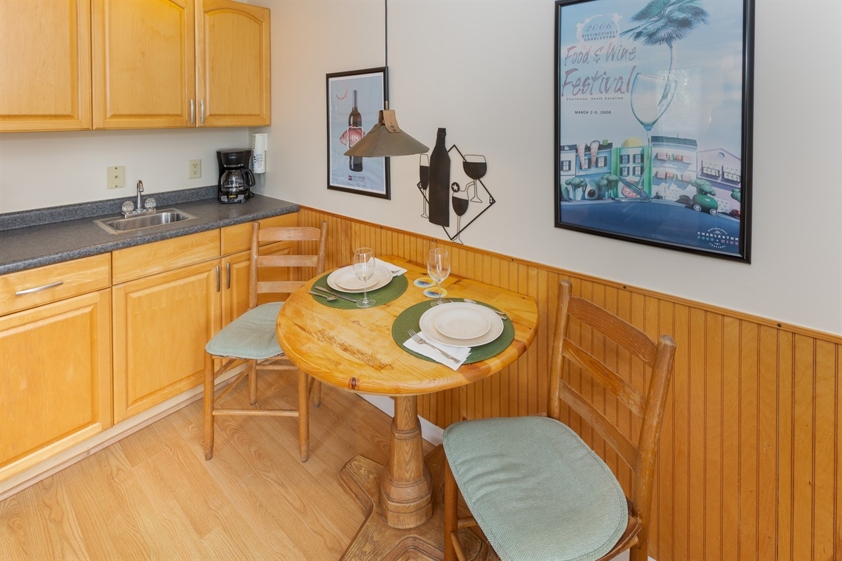 Welcome to this cozy living space where you can relax, watch TV and plan your day at the beach.