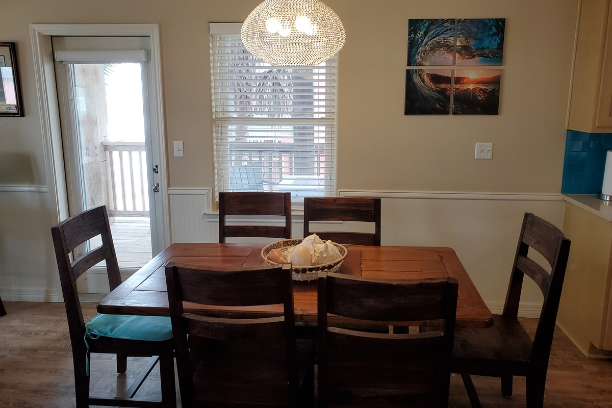 Here's the dining table and chairs with room for eight.