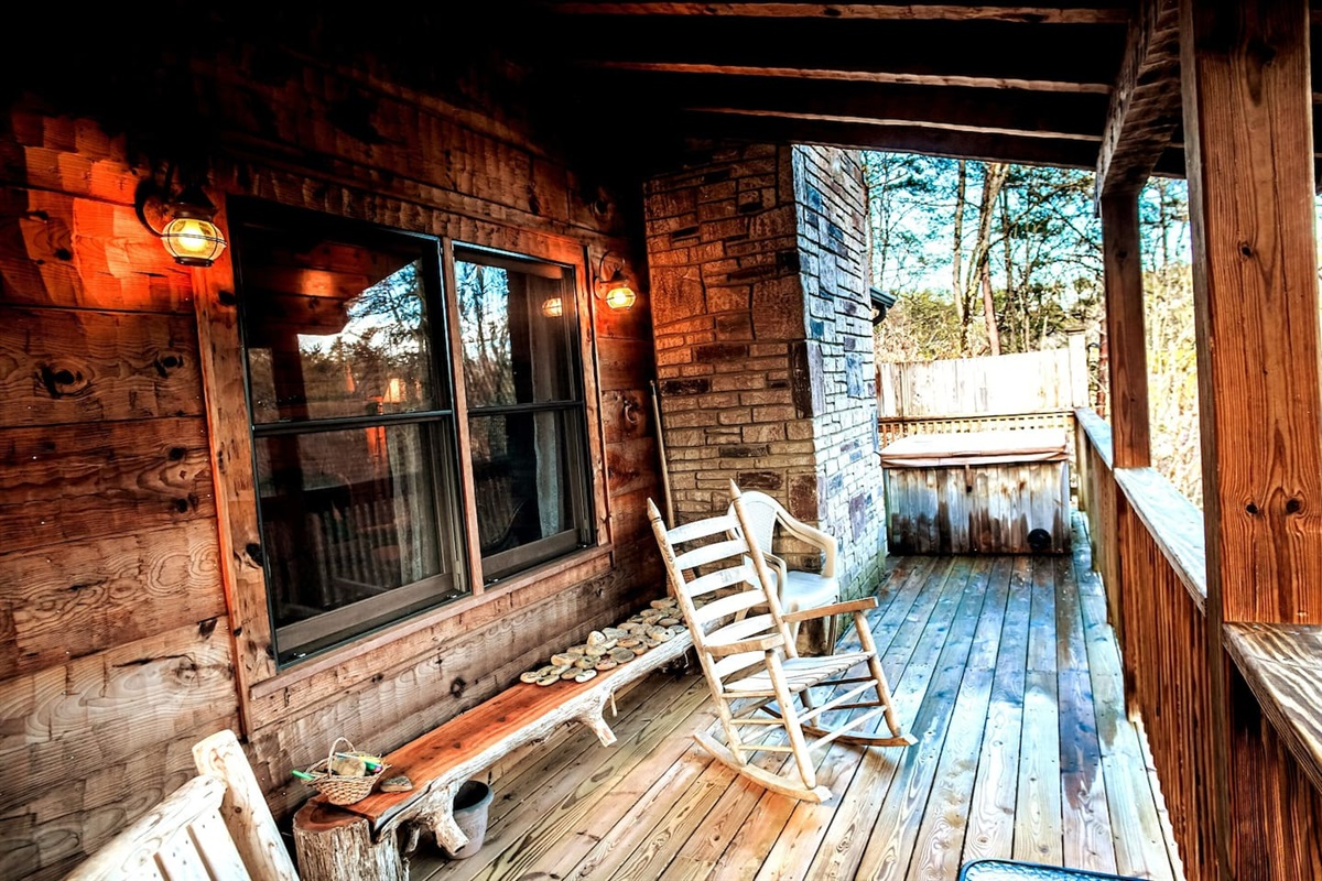 SIt back on the porch and rock away any stress (or jump in the hot tub)