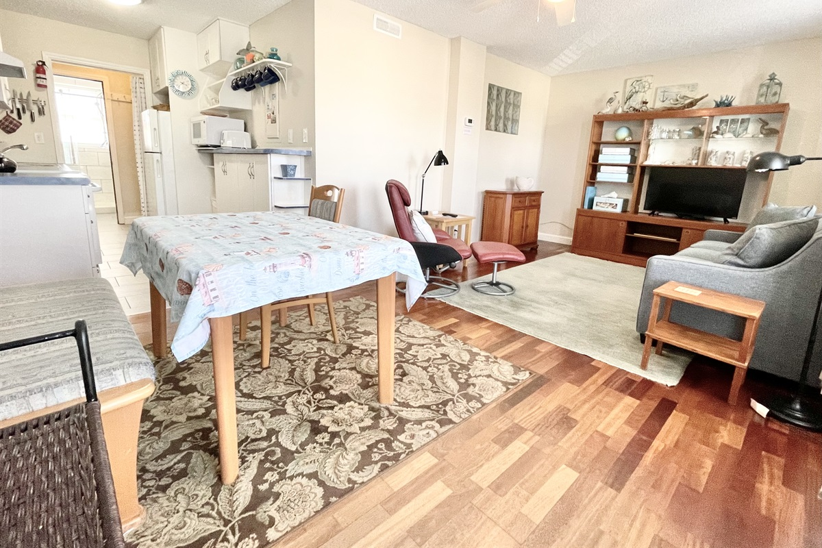 Open design of this 1br condo with great use of space.  Dining table for dining or use while working remotely.